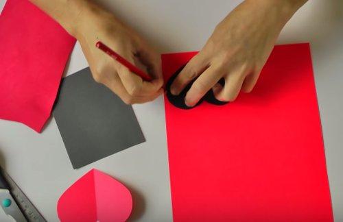 Draw a heart shape on paper
