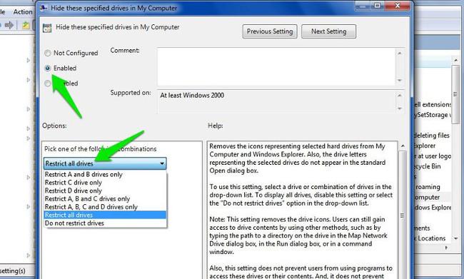Trên cửa sổ Hide these specified drives in My Computer click chọn Enable để kích hoạt tùy chọn.
