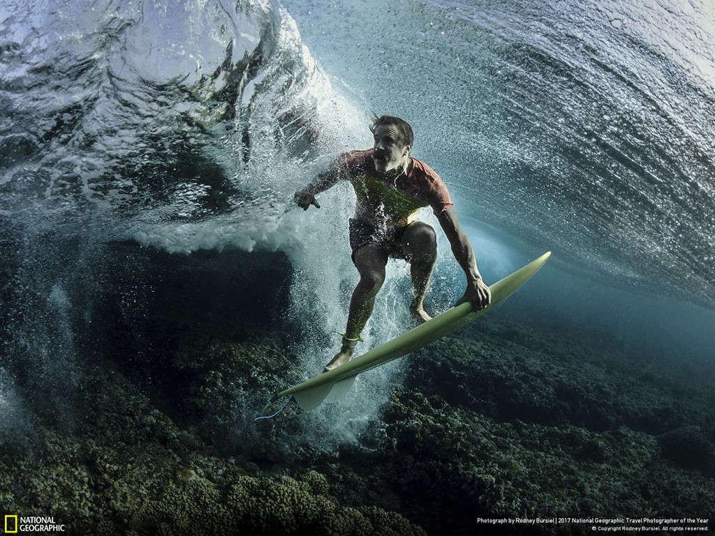 Rodney Bursiel has captured an interesting wave image around a man surfing in the waters off Tavarua, Fiji.
