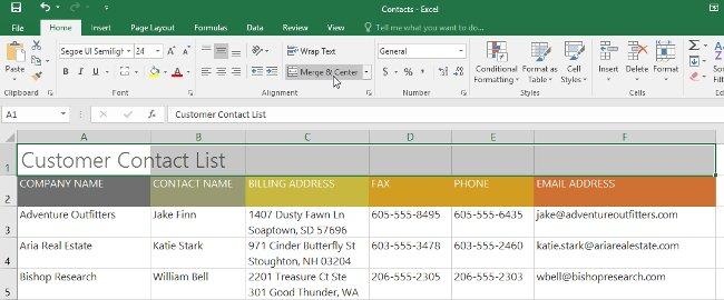 Nhấp vào lệnh Merge & Center trên tab Home