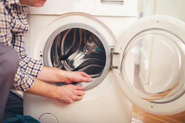 Vệ sinh máy giặt cửa ngang đơn giản với 4 cách làm này - Quantrimang.com