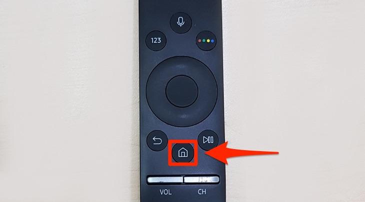 Chọn nút có hình ngôi nhà ở trên điều khiển